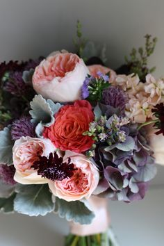 pale pink and coral roses, purple scabiosa, dusty miller and hydrangeas, lavender can be added.