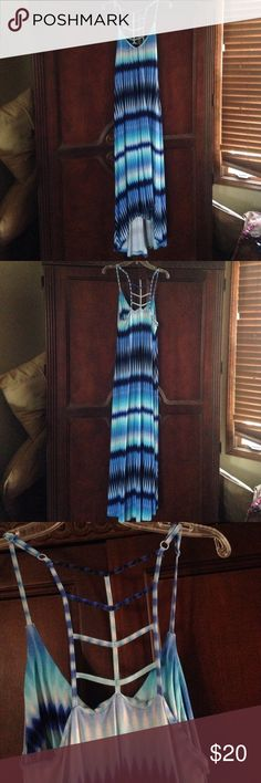GORGEOUS high low maxi dress Beautiful Cynthia Rowley maxi dress (high low hem). Lovely blue, green turquoise colored reminiscent of the Caribbean waters. Shelf bra. Fun caged back straps. Straps are adjustable. Excellent condition. Size small. Cynthia Rowley Dresses High Low