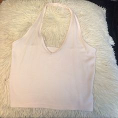 Brandy Melville Lena  halter light pink Light pink Brandy Melville Lena halter. Doesn't have Brandy because it wasn't seen on properly (I added the pic from online store where I ordered it from) and is in brand new condition otherwise. Brandy Melville Tops Crop Tops