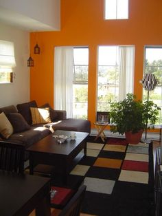 Orange living room design | Warm Paint Colors for Living Room | homienice.com