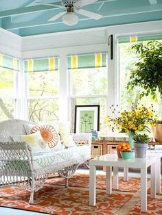 Orange rug color scheme for your sunroom. To determine the size you need: pull all your chairs away from table as if you were trying to get up and measure from back legs. This way your chair will always be on the rug. Typically 9x11 for rectangular table with 6 chairs.