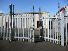 Electric fence with access via electrified double leaf swing gates into industrial premises. Security Fencing, Electric Fencing, Perimeter Security, Boundary Walls, Wildlife Park, Fence Gate, Gates, Entrance, Industrial