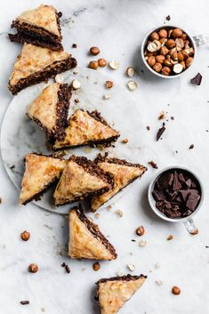 An out-of-this-world Chocolate Hazelnut Baklava soaked in a cocoa nib and honey syrup. From the Sofra bakery cookbook Soframiz! An out-of-this-world Chocolate Hazelnut Baklava soaked in a cocoa nib and honey syrup. From the Sofra bakery cookbook Soframiz! Chocolate Baklava, Chocolate Hazelnut, Chocolate Recipes, Hot Chocolate, Hazelnut Recipes, Chocolate Chips, Just Desserts, Dessert Recipes, Holiday Desserts