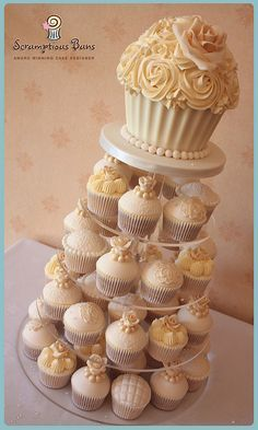 ivory, gold, silver wedding cake with cupcakes - Google Search