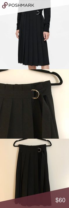 COS Pleated Wrap Skirt A wrap-over style, this skirt is made from a crepe material with deep pleats. Designed with a D-ring fabric belt, it has two inside buttons for an adjustable waist, a simple, straight hemline and laser cut finishes. Back length is 62cm / 100% Polyester / Machine washable / Product no. 0409826002 COS Skirts Midi