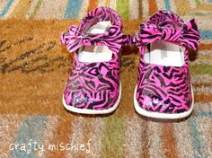 Repurpose scuffed shoes with duct tape, mod podge and acrylic sealer. She had another post earlier with black and white zebra mary janes. so cute.