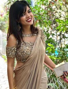 Latest Cold Shoulders Blouse Designs Cold shoulder saree blouse design is a stunning combination for parties, festivals and wedding wear. Traditional Indian attire makes women elegant and breathtaking. To team up with the sarees, lehe… Netted Blouse Designs, Saree Blouse Neck Designs, Fancy Blouse Designs, Bridal Blouse Designs, Latest Blouse Designs, Golden Blouse Designs, Latest Blouse Patterns, Indian Blouse Designs, Saree Blouse Patterns