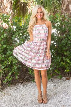 It's no mystery why we love this darling dress - with a gorgeous combination of florals and semi-sheer stripes, this is such a unique look for any event! The floral print features light pink, bright g