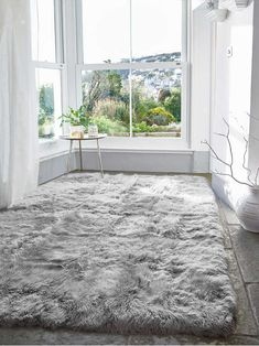 Our new Nordic sheepskin collection is top quality and includes beautiful sheepskin rugs, sheepskin cushions, sheepskin seat cushions and sheepskin poufs and sheepskin chair pads. Living Room Carpet, Bedroom Carpet, Rugs In Living Room, Fluffy Rugs Bedroom, Bedroom Flooring, Room Rugs, Grey Rugs, My New Room, Bedroom Decor