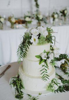 Modern white wedding cake with florals!
