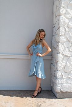 Summer outfit inspo. Blue Chambray ruffle faux wrap dress. Shop the look.