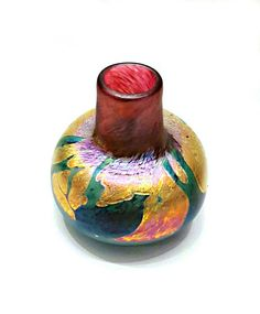 ~ Please click on the pictures to enlarge to a full view. A strikingly beautiful hand blown Studio made Art Glass Vase. Signed by California, USA artist Bruce Stowell and dated 98. Very heavy and colorful with flower like decor multicolored iridescent glass with hues of pinks, gold &