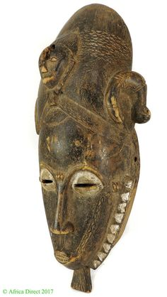 A beautiful, small sun/moon mask from the Baule tribe. They can be distinguished by the round shape of the face and delicate zigzag motif around the circumference. African Masks, African Art, Japanese Mask, Ivory Coast, Lion Sculpture, Statue, Portrait, Antiques, Antiquities