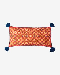 Silk embroidered bolster-style cushion, based on a vintage Indian design. Plain cotton backing and reverse. Self covered buttons and rouleau loop to fasten at side with lip to conceal cushion filler.