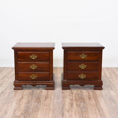 This pair of neoclassical nightstands is featured in a solid wood with a glossy medium cherry toned finish. These end tables are in great condition with with 2 large drawers, shiny brass hardware and carved bracket feet. Simple bed side tables with tons of storage! #neoclassical #dressers #nightstand #sandiegovintage #vintagefurniture