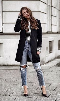 Ripped jeans can be classy too. Boyfriend jeans get a chic upgrade with stiletto heels and a fitted black blazer. #winteroutfits #winter #outfits