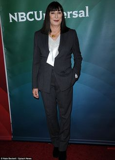 Monochrome chic: Anjelica, who plays theatre producer Eileen Rand in hit NBC show Smash, looked smart in a black suit and white shirt for the event