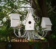 birdhouse chandelier I made from Goodwill chandy and unfinished birdhouses from Michaels.  Just hit the whole thing with white spray paint and hung on tree in back yard.  In between birdhouses are tea cups and saucers for seed or water. pinned with Bazaart