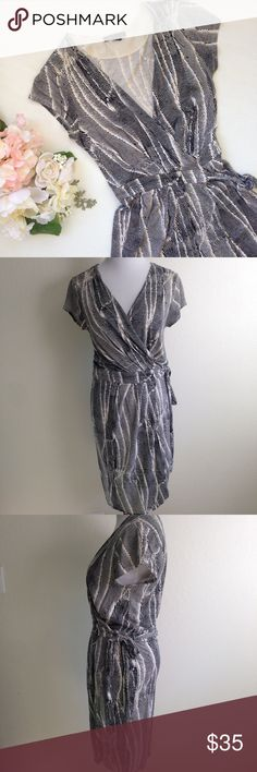 """BANANA REPUBLIC Teresa Wrap Dress Beautiful full wrap dress from Banana Republic. Short sleeve, deep v neck, tulip skirt, gathered waist. Colors are black & cream. Approx flat meas: length 38"""", sleeve 4.5"""", total width of dress at waist when opened 38.5"""". 70% rayon 30% Lyocell machine wash. No rips stains or holes Banana Republic Dresses"""