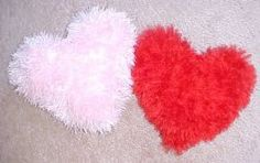 Make these Valentine's Day pillows for your chair or bed.  This free knitting pattern is perfect for any heart lover.  The fuzzy yarn gives a nice playful feeling to these oh-so-cute pillows.