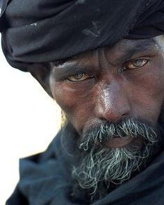 An intense look from a Tuareg man. The Tuareg are Berber people with a traditionally nomadic pastoralist lifestyle. They are the principal inhabitants of the Saharan interior of North Africa. Cultures Du Monde, World Cultures, We Are The World, People Around The World, Many Faces, Interesting Faces, Black People, Belle Photo, Portrait Photography