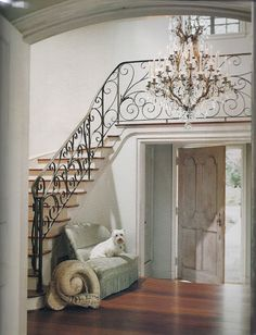 The two story entry hall shows the original Finger designed romantic railing. Walnut wood floors, and a charming antique settee, typical of Babs Watkins aesthetic. Stonehenge, Interior Exterior, Interior Design, Interior Ideas, Foyer Staircase, Iron Staircase, Iron Railings, Curved Staircase, Walnut Wood Floors