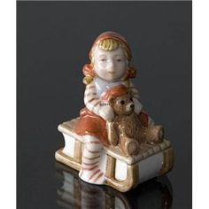 Pixie on Sleigh with a teddy bear, Royal Copenhagen Christmas figurine