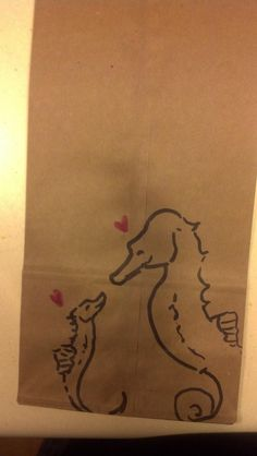 Twitter / mcahogarth: Daddy is picking Child up today, so today's Lunchbag art is Daddy and baby seahorse!