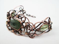 B.C. Jade copper cuff bracelet with Green Tourmaline stones on either side. One of our 'one of a kind' pieces. www.thetimacollection.com