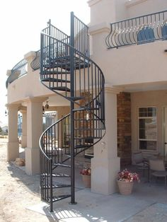 Best Spiral Staircase Design Ideas That Would Beautify Your Home Generally when we plan for home renovation, we do not keep attention on staircases but we must do. Here are some spiral staircase design for your home to make it look modern. Spiral Staircase For Sale, Spiral Staircase Outdoor, Spiral Stairs Design, Stair Railing Design, Outdoor Stairs, Staircase Design Modern, Wrought Iron Stair Railing, Staircase Railings, Iron Staircase