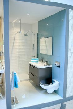 blue / steel / Leroy Merlin Bathroom Showroom by Ana Antunes