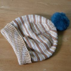 Tourie (beanie) made from wooled dyed with dochan seeds.
