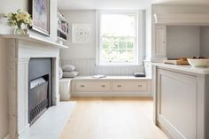 Georgian Farmhouse Kitchen, Hampshire - Humphrey Munson Kitchens - banquette seating with drawers below. Banquette Seating In Kitchen, Kitchen Dining, Kitchen Cabinets, Cozy Kitchen, Kitchen Decor, Farmhouse Dining Room Lighting, Fireplace Seating, Stove Fireplace, Layout