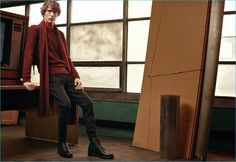 Sven de Vries models a matching scarf and crewneck sweater in red, from BOSS' fall-winter 2016 collection.