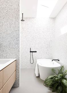 This walk-in shower by Zunica has all the awesomeness: a bathroom tile accent wall, black hardware, wing wall, and massive soaking tub. Throw in a skylight and fern for good measure and you might as well take my heart. #bathroom inspiration via www.L-2-Design.com