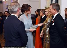 Bond girls Lea Seydoux and Monica Bellucci certainly disappoint as they put on stunning shows on the red carpet of the royal screening. Royal Albert Hall, Jenny Packham, Monica Bellucci, Duchess Kate, Duchess Of Cambridge, Prince Harry, James Bond, Kate Middleton, Daniel Craig Spectre