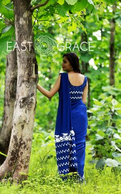 Featuring a rich navy blue pure silk chiffon saree with organza flowers and silken white birdies and beautiful vines with ribbonwork white leaves along the bottom.  Here's a saree to invoke that feminine mystique in you.  PRICE: INR 15,400.00; USD 233.33  To buy click here: https://www.eastandgrace.com/products/white-blue-birdies  For help reach us at care@eastandgrace.com. With love www.eastandgrace.com