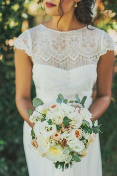 We love this dress and bouquet combination - classic with a hint of boho!