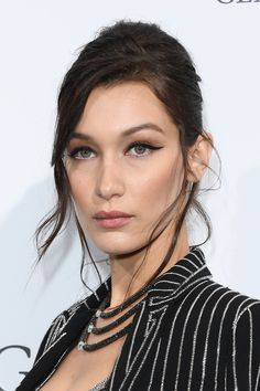 Daily beauty muse - Bella Hadid   To contrast with her striking, glitzy jacket at the De Grisogono party in Cannes, Bella Hadid kept her make-up rather minimal, with just a bold, feline flick on her eyes. The trick to applying your eyeliner in a perfectly straight line is to find a formula which works for you. For Hadid's thick, sharp line, we suggest that you use a liquid-liner pen. YSL Automatique Effet Faux Cils Shocking Eye Liner, £26, gives laser-like precision.