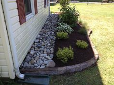 Bugs can be a problem when mulch is too close to the land house. Adding rocks can help that problem and also keeps heavy rain from splashing muddy mulch all over the siding.(that's really why we put it there, bugs are hardly ever a problem in this area) River Rock Landscaping, Landscaping Around House, Landscaping With Rocks, Outdoor Landscaping, Front Yard Landscaping, Backyard Landscaping, Outdoor Gardens, Backyard Ideas, Ranch House Landscaping