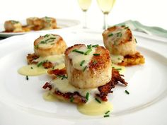 """Seared Scallops Over Celeriac Pancakes with Champagne Beurre Blanc....a very elegant, yet do-able recipe.  I am, however, not familiar with celeriac.   And how do you """"peek"""" celeriac.  I will be checking this out on """"Google""""."""