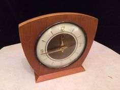 Vintage mid century Smiths mechanical mantle clock in teak wooden case. - $40