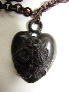 Victorian carved jet necklace with hair compartment.