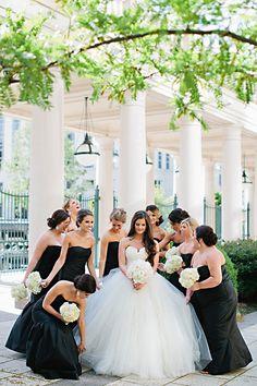 Bride with Bridesmaids in Black Gowns | Brides.com
