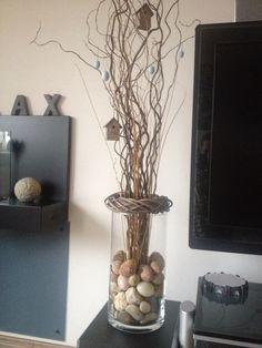 Vase mit Zweigen