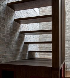 A skylight illuminates the stairwell inside this house by Liddicoat & Goldhill