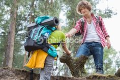 Stock Photo : Young male hiker helping woman in climbing cliff at forest Cliff, Climbing, Stock Photos, Woman, Image, Rock Climbing, Mountaineering, Hiking