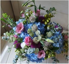 This beautiful bouquet from the Tregothnan estates would be perfect for a wedding with a British theme in soft dusky pink, white and blue.