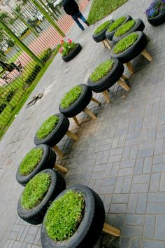 recycled tyres used as planters in Invasion Verde, a public park in Lima, Peru #parks #repurposed