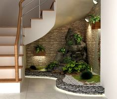 If you have an empty space under the stairs in your home, then maybe you can use this space for an indoor garden. And not any type of garden, but a small pebble garden that will